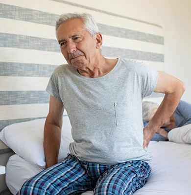 Older man with backache