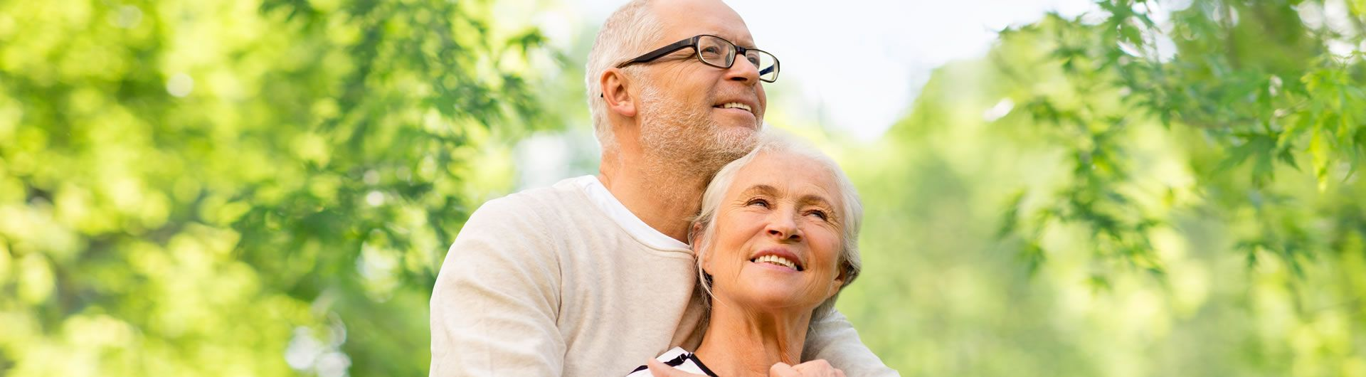 Happy mature couple with natural green background